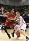 Wofford guard Trevor Stumpe (15) controls the ball against VMI forward Tragen Fahl (1) in the second half of an NCAA college basketball game for the Southern Conference basketball tournament championship, Saturday, March 9, 2018, in Asheville, N.C. Wofford won 99-72. (AP Photo/Kathy Kmonicek)