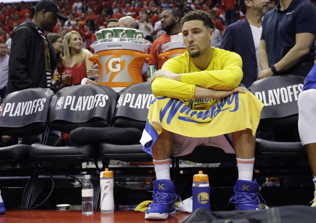 Golden State Warriors guard Klay Thompson (11) sits on the bench during the second half in Game 2 of the NBA basketball Western Conference Finals against the Houston Rockets, Wednesday, May 16, 2018, in Houston. (AP Photo/David J. Phillip)