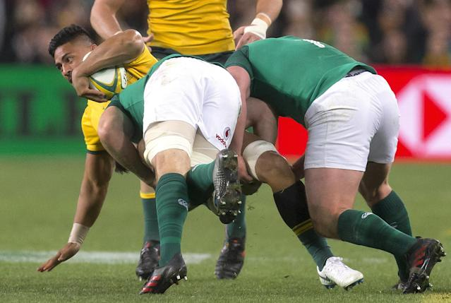 Rugby Union - June Internationals - Australia vs Ireland - Sydney Football Stadium, Sydney, Australia - June 23, 2018 - Peter Samu of Australia is tackled by players from Ireland. AAP/Craig Golding/via REUTERS ATTENTION EDITORS - THIS IMAGE WAS PROVIDED BY A THIRD PARTY. NO RESALES. NO ARCHIVE. AUSTRALIA OUT. NEW ZEALAND OUT.