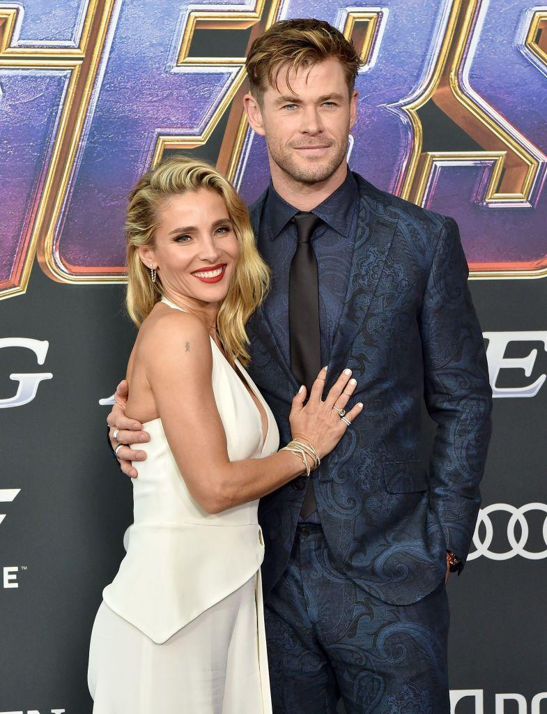 "<p>""In this image Elsa's hand is on Chris' chest which hints at feelings of possessiveness. A he-is-mine-type hold,"" Donaldson says. It's her way of telling onlookers that they're a unit (and making sure no one forgets it), while also showing pride in their marriage. </p><p>Chris' body language exudes all kinds of confidence in his relationship. Donaldson explains having a hand in your pocket can either mean you're nervous or ""cool and sexy."" In this case, because of his posture and the way he's pulling Elsa in, he falls into the self-assured camp. </p>"
