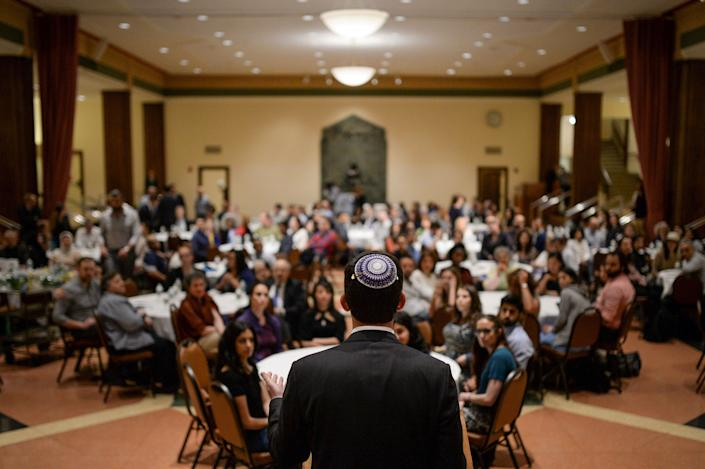 Rabbi Joshua M. Davidson addresses interfaith attendees at an Iftar feast during Ramadan hosted at the Temple Emanu-El in Manhattan, New York, U.S., June 15, 2017. Image taken on June 15, 2017. REUTERS/Amr Alfiky