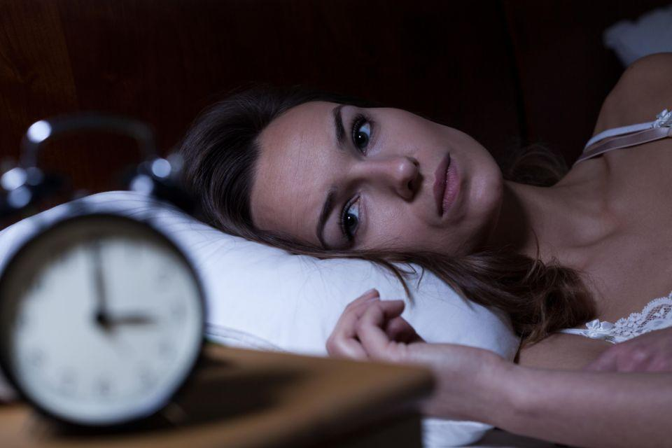 Going to bed too early could leave you staring at the ceiling unable to fall asleep. Photo: Getty