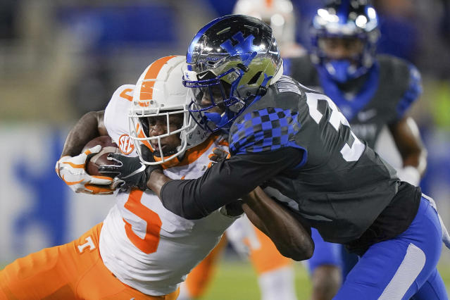 Tennessee wide receiver Josh Palmer (5) is tackled by Kentucky defensive back Jamari Brown (32) during the first half of an NCAA college football game, Saturday, Nov. 9, 2019, in Lexington, Ky. (AP Photo/Bryan Woolston)