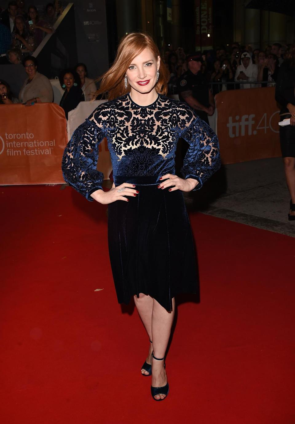 <p>She might not have worn face jewelry, but Jessica Chastain still shined at the film's TIFF debut in a navy blue velvet dress with a midi-hemline and matching shoes. </p>