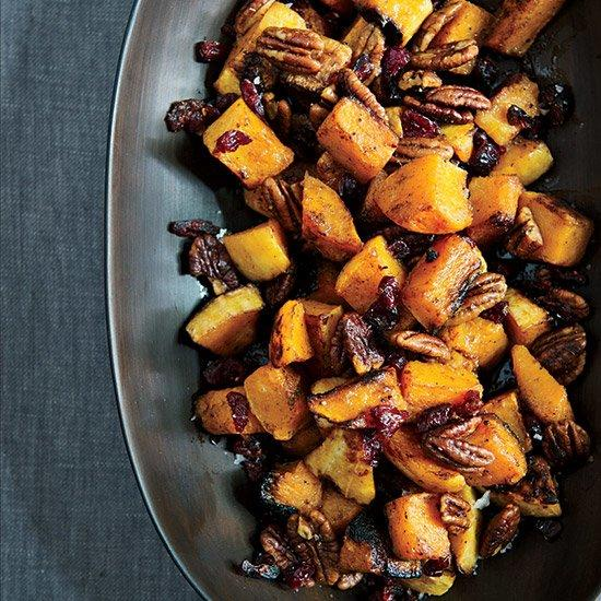"""<p><strong>Chef: Marcus Samuelsson</strong><br /> Chef Marcus Samuelsson puts an Ethiopian twist on spiced pecans, which he tosses with sweet roasted butternut squash in an orange dressing.</p><p><a href=""""http://preview.foodandwine.com/recipes/roasted-butternut-squash-with-spiced-pecans"""">GO TO RECIPE</a></p>"""