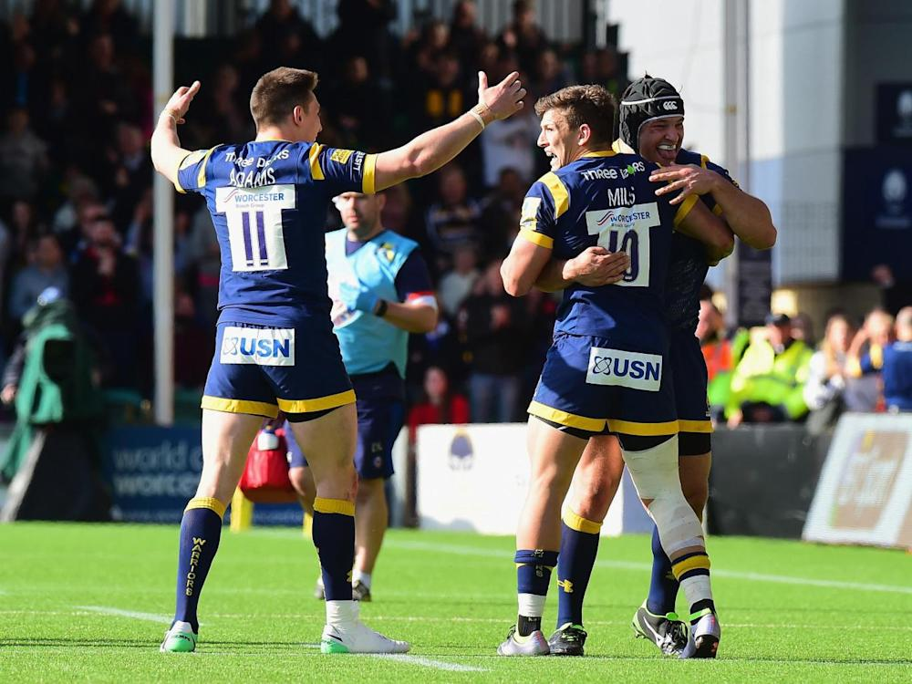 Josh Adams, Ryan Mills and Joe Taufetee celebrate (Getty)