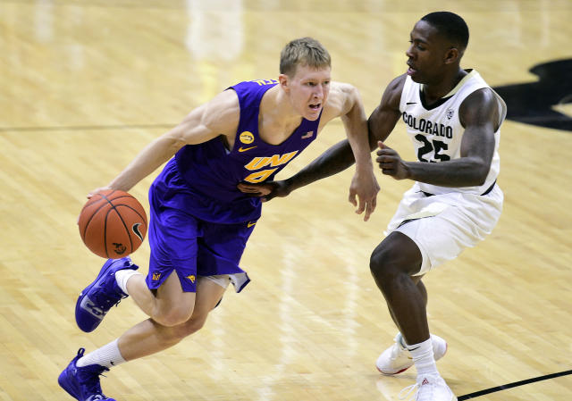 Northern Iowa guard AJ Green, left, drives to the rim as Colorado guard McKinley Wright IV defends, Tuesday, Dec. 10, 2019, in Boulder, Colo. (AP Photo/Cliff Grassmick)