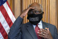 FILE - In this Sept. 17, 2020, file photo, House Majority Whip James Clyburn of South Carolina shields his eyes from a television light to look at a reporter asking a question during a news conference with House Speaker Nancy Pelosi on Capitol Hill. Clyburn and other Democrats blamed rhetoric about defunding local police departments for the party's surprise loss of seats in the House. (AP Photo/Jacquelyn Martin, File)