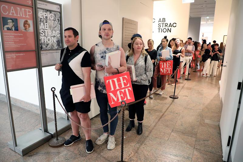 Museumgoers line up for their signed copy