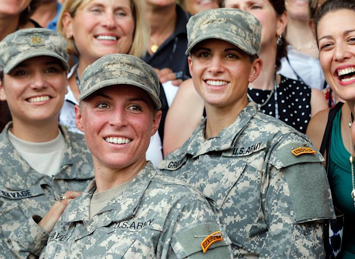 Army 1st Lt. Shaye Haver, center, and Capt. Kristen Griest, right, pose for photos on Aug. 21, 2015, at Fort Benning, Ga., after becoming the first female graduates at the Army's Ranger School.