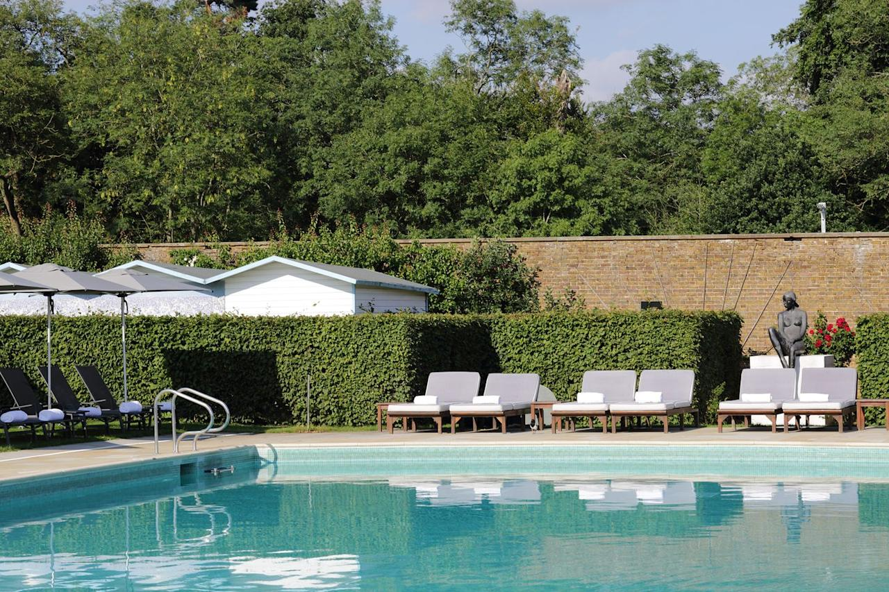 """<p>Sitting amid 300 acres of verdant Hertfordshire countryside, this five-star hotel with an outdoor pool is close to London while feeling a world away. </p><p>The swimming pool is set within The Grove's walled garden, alongside a beach filled with deckchairs - who needs to head to a crowded beach when you've got it all here?</p><p>A serene spot for an outdoor swim, the heated pool is where you can stretch out and soak up the rays on one of the padded sun loungers. There's also the Gazebo serving up drinks in the summer and the Potting Shed overlooking the pool, where you can sink into a comfy armchair with a board game.</p><p><a class=""""body-btn-link"""" href=""""https://go.redirectingat.com?id=127X1599956&url=https%3A%2F%2Fwww.booking.com%2Fhotel%2Fgb%2Fthe-grove-hertfordshire.en-gb.html&sref=https%3A%2F%2Fwww.harpersbazaar.com%2Fuk%2Ftravel%2Fg33508196%2Fhotels-with-outdoor-pools%2F"""" target=""""_blank"""">BOOK NOW</a></p>"""
