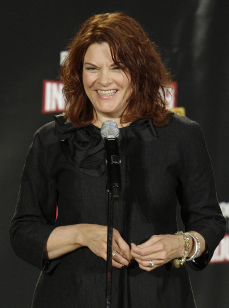 """FILE - In this April 4, 2009 file photo, singer Rosanne Cash speaks in the backstage during the 2009 Rock and Roll Hall of Fame Induction Ceremony in Cleveland. With a best-selling memoir and an album that never seemed to stop resonating with fans, Rosanne Cash celebrated the end of 2010 with a long break full of restful sleep. Cash is up for a Grammy Award for """"The List,"""" her tribute to her iconic father, Johnny Cash. (AP Photo/Ron Schwane, file)"""
