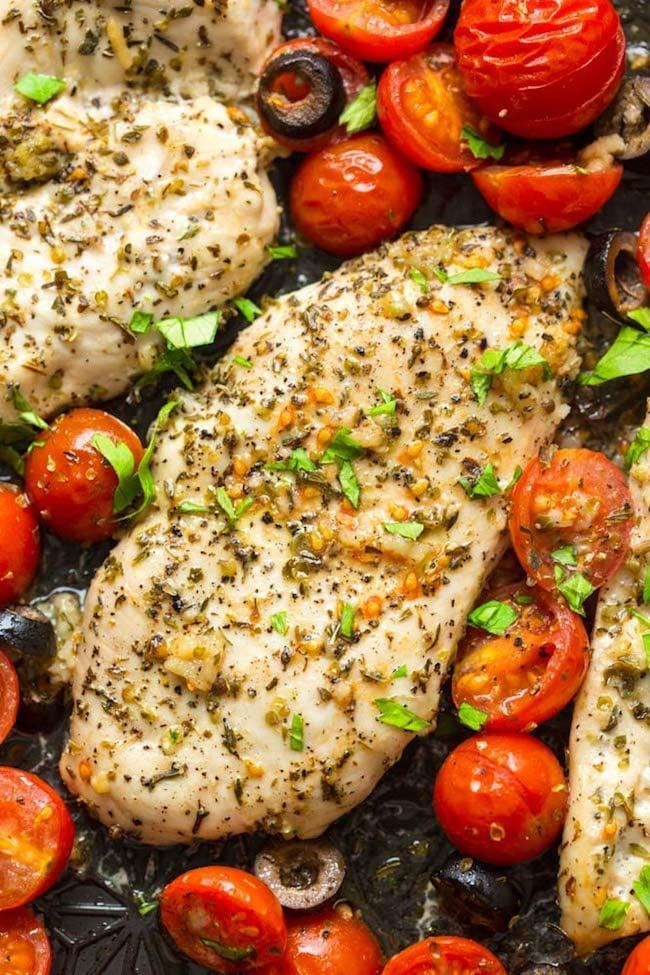 """<p>Cherry tomatoes add a burst of flavor to this herb-rubbed chicken. While it's cooking, spiralize some cucumber or <a href=""""https://www.popsugar.com/food/How-Cook-Zucchini-Noodles-43337710"""" class=""""link rapid-noclick-resp"""" rel=""""nofollow noopener"""" target=""""_blank"""" data-ylk=""""slk:zucchini noodles"""">zucchini noodles</a> to serve on the side.</p> <p><strong>Get the recipe:</strong> <a href=""""https://www.asaucykitchen.com/baked-italian-chicken/"""" class=""""link rapid-noclick-resp"""" rel=""""nofollow noopener"""" target=""""_blank"""" data-ylk=""""slk:baked Italian chicken with cherry tomatoes"""">baked Italian chicken with cherry tomatoes</a></p>"""