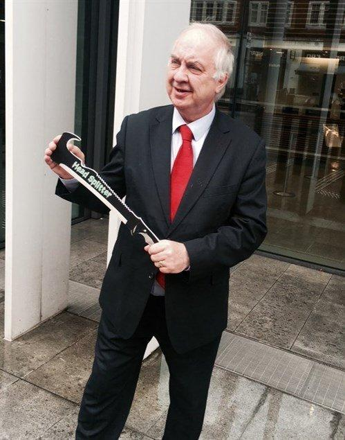 David Jamieson poses with a 'Head Splitter' during his campaign to ban zombie knives (West Midlands Police And Crime Commissioner)