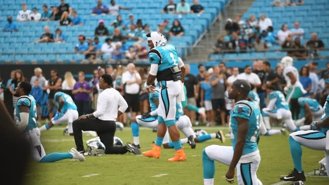 Carolina Panthers quarterback Cam Newton shows off his dance moves during the pregame warmups against the Miami Dolphins.