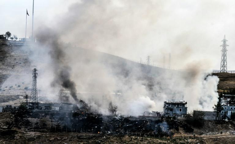 Smoke rises from damaged police headquarters after a suicide truck bombing killed eleven Turkish police officers and injured 78 people on August 26, 2016 in Cizre, southeastern Turkey, in an attack that was blamed on Kurdish militants by state media
