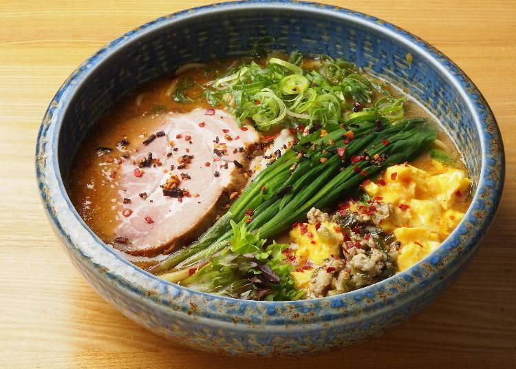 'Genki-no-deru Miso Ramen DX' (\1,200), is made using thick noodles and ample toppings, including native alpine leek and roasted pork fillet. A smaller version for \900 is also available.