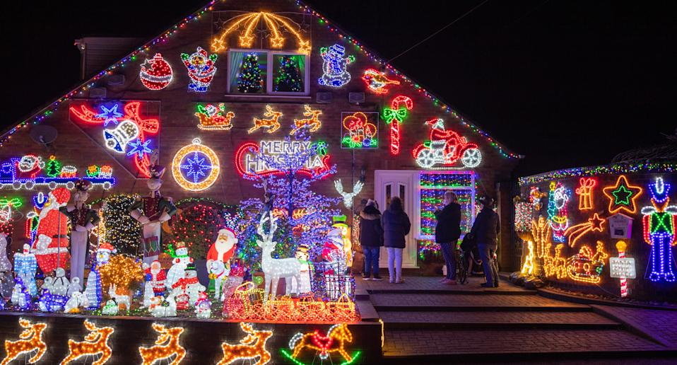 House decorated for Christmas is shown.