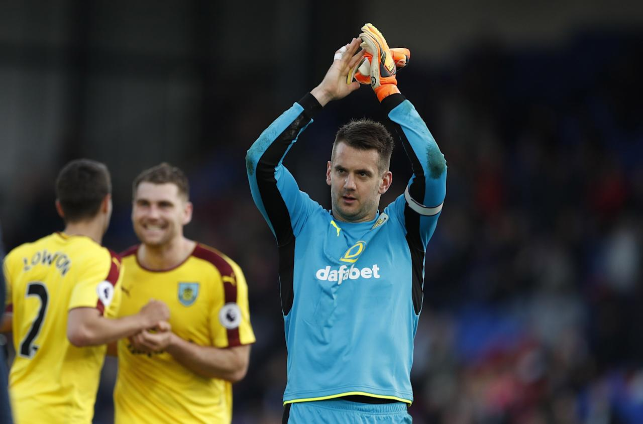 <p>Burnley's Tom Heaton celebrates after the game </p>