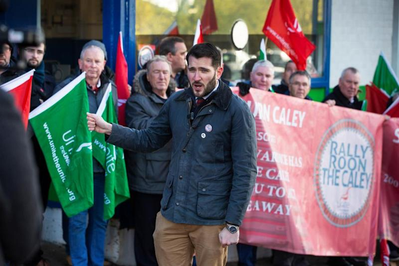 Paul Sweeney, Labour candidate for Glasgow North East, joins former employees from the Caley railway works at a protest last month.