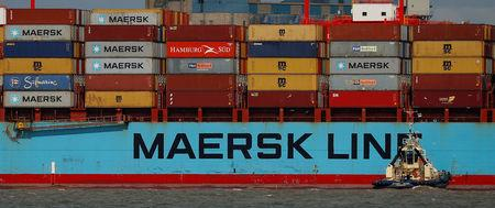 FILE PHOTO: The Maersk Line container ship Maersk Sentosa is helped by tugs as it navigates the River Mersey in Liverpool