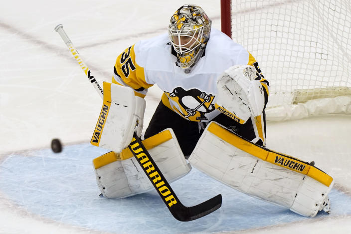 Pittsburgh Penguins goaltender Tristan Jarry (35) makes a save during the second period of an NHL hockey game against the New Jersey Devils, Sunday, April 11, 2021, in Newark, N.J. (AP Photo/Kathy Willens)
