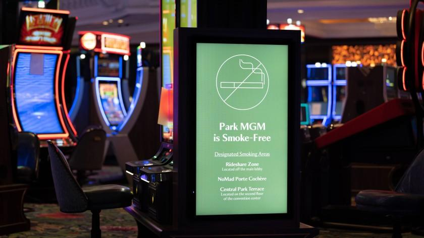 A sign on the smoke-free gaming floor at Park MGM directs guests to various outdoor locations where they can light up. When it reopens September 30, the resort will be the first one along The Strip to fully ban smoking. (MGM Resorts)