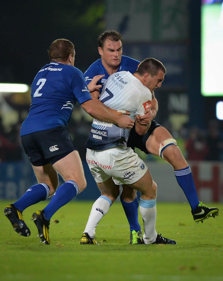 Cardiff Blues Sam Warburton (centre) is tackled by Leinster Rugby's Rhys Ruddock (right) and Sean Cronin (left) during the RaboDirect PRO12 match at the RDS Arena, Dublin, Ireland.