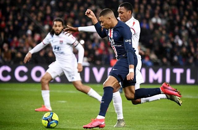 Kylian Mbappe in action for Paris Saint-Germain in their 4-2 win over Lyon (AFP Photo/FRANCK FIFE)