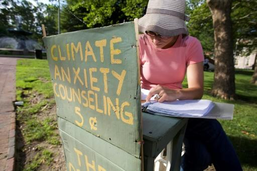 """Kate Schapira, a 40-year-old senior lecturer in the English department at Brown University, mans her """"climate anxiety"""" booth in Providence"""
