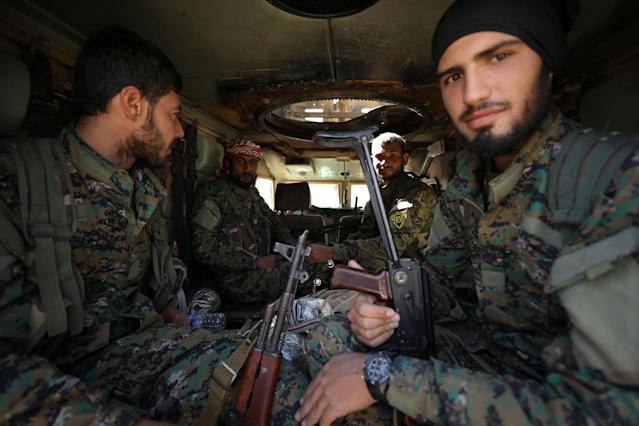 <p>Fighters of the Syrian Democratic Forces (SDF) sit inside a vehicle in Raqqa, Syria, Oct. 16, 2017.<br> (Photo: Rodi Said/Reuters) </p>