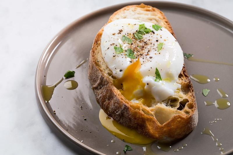 Serve the poached egg in a stewed tomato sauce, on toast with hollandaise sauce, or simply topped with salt, pepper, oil, and herbs.