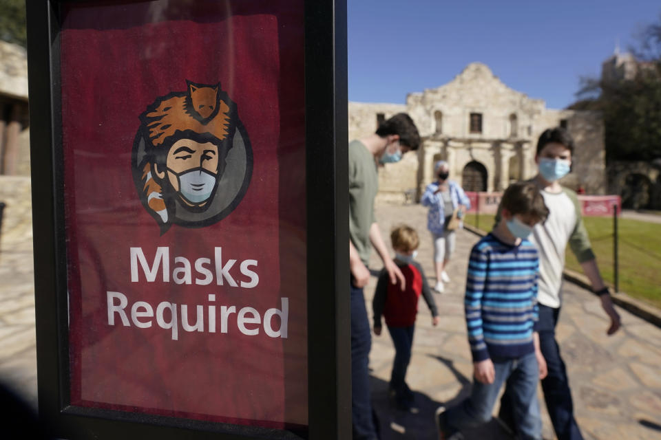 Visitors wearing face masks leave the Alamo, Wednesday, March 3, 2021, in San Antonio. Gov. Greg Abbott says Texas is lifting a mask mandate and lifting business capacity limits next week. (AP Photo/Eric Gay)