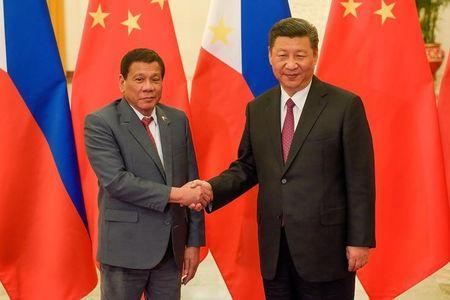 Chinese President Xi Jinping shakes hands with Philippines President Rodrigo Duterte prior to their bilateral meeting during the Belt and Road Forum, at the Great Hall of the People in Beijing