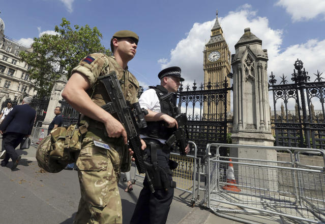 <p>A member of the army joins police officers in Westminster, London, May 24, 2017. Britons will find armed troops at vital locations Wednesday after the official threat level was raised to its highest point following a suicide bombing that killed more than 20, as new details emerged about the bomber. (Photo: Tim Ireland/AP) </p>