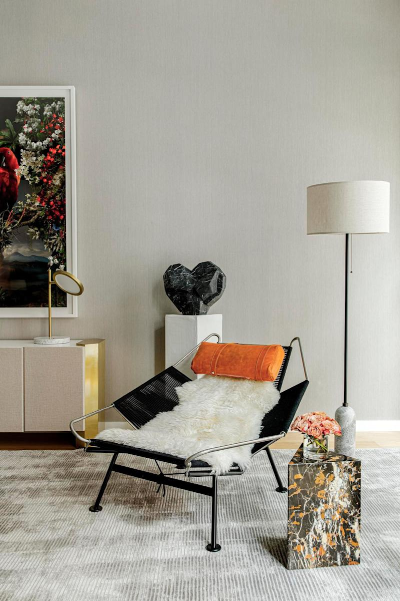 Texture, pattern, and color strike at every moment. We love the marble meets sheepskin meets angular edges.