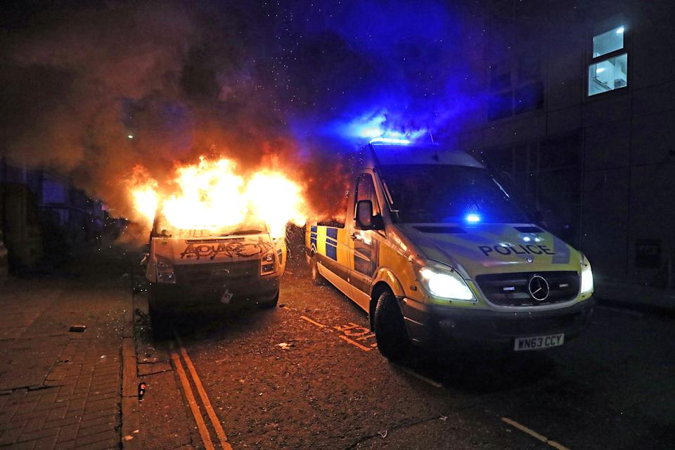 A vandalised police van on fire outside Bridewell Police Station, as other police vehicles arrive after protesters demonstrated against the Government's controversial Police and Crime Bill. Picture date: Sunday March 21, 2021.