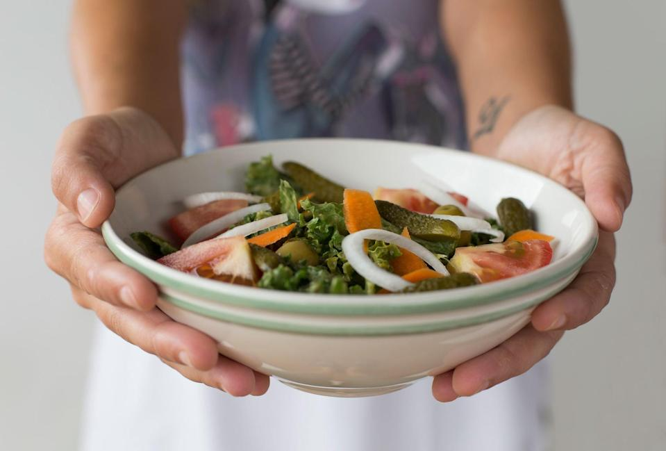 """<p>Ensure that you're eating enough calories during your window. If you don't, registered dietitian Leslie Langevin, MS, and author of <strong><a href=""""https://www.anti-inflammatorykitchen.com/"""" class=""""link rapid-noclick-resp"""" rel=""""nofollow noopener"""" target=""""_blank"""" data-ylk=""""slk:The Anti-Inflammatory Kitchen Cookbook"""">The Anti-Inflammatory Kitchen Cookbook</a></strong>, explained that it can cause """"<a href=""""https://www.popsugar.com/fitness/photo-gallery/45490439/image/45490452/Youre-Stuck-Starve-Binge-Cycle"""" class=""""link rapid-noclick-resp"""" rel=""""nofollow noopener"""" target=""""_blank"""" data-ylk=""""slk:the binge and restrict cycle"""">the binge and restrict cycle</a>."""" If you don't eat enough on Monday and then on Tuesday you end up bingeing, if this cycle continues, it can lead to weight gain. And if being too hungry makes you eat outside of your planned window, it means you're not being consistent with IF.</p> <p>In making sure you eat enough, you don't want to dip <a href=""""https://www.popsugar.com/fitness/How-Many-Calories-Should-I-Eat-Day-45665062"""" class=""""link rapid-noclick-resp"""" rel=""""nofollow noopener"""" target=""""_blank"""" data-ylk=""""slk:under 1,200 calories daily"""">under 1,200 calories daily</a>. If you do, then intermittent fasting may not be the cause for your weight gain, it's just the fact that you're not eating enough on some days and then eating too much on other days. In this case, intermittent fasting might not be for you, especially if you have a history of <a href=""""https://www.popsugar.com/fitness/what-is-disordered-eating-46832666"""" class=""""link rapid-noclick-resp"""" rel=""""nofollow noopener"""" target=""""_blank"""" data-ylk=""""slk:disordered eating"""">disordered eating</a>.</p> <p>If you are caught in this cycle, Langevin suggested reducing your fasting window to maybe 12 or <a href=""""https://www.popsugar.com/fitness/1410-Intermittent-Fasting-Still-Beneficial-45431472"""" class=""""link rapid-noclick-resp"""" rel=""""nofollow noopener"""" target=""""_blank"""" data-ylk=""""slk:14 hours"""">14 hours</a>. """"This ca"""