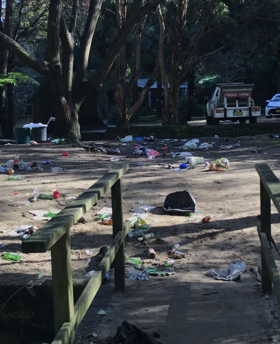 Photo shows mess left in Cooper Park, Sydney, after a party on Saturday night.