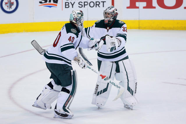 Minnesota Wild goaltender Devan Dubnyk (40) is replaced by goaltender Alex Stalock (32) during first period against the Winnipeg Jets in Game 5 of an NHL hockey first-round playoff series in Winnipeg, Manitoba, Friday, April 20, 2018. (John Woods/The Canadian Press via AP)