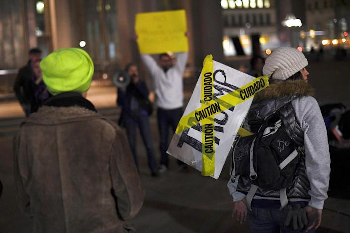 <p>Casey Carrion (rignt) carries a sign as she join protestors demonstrating against the election of Republican Donald Trump as President of the United States in Philadelphia, Pa., on Nov. 14, 2016. (Mark Makela/Reuters) </p>