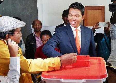 Madagascar presidential candidate Andry Rajoelina casts his ballot during the presidential election at a polling centre in Ambatobe, Antananarivo