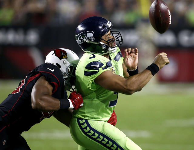 """<a class=""""link rapid-noclick-resp"""" href=""""/nfl/teams/sea/"""" data-ylk=""""slk:Seattle Seahawks"""">Seattle Seahawks</a> quarterback <a class=""""link rapid-noclick-resp"""" href=""""/nfl/players/25785/"""" data-ylk=""""slk:Russell Wilson"""">Russell Wilson</a> (3) loses the ball out of bounds as he is hit by <a class=""""link rapid-noclick-resp"""" href=""""/nfl/teams/ari/"""" data-ylk=""""slk:Arizona Cardinals"""">Arizona Cardinals</a> inside linebacker <a class=""""link rapid-noclick-resp"""" href=""""/nfl/players/30126/"""" data-ylk=""""slk:Haason Reddick"""">Haason Reddick</a> (43) during the second half of an NFL football game, Thursday, Nov. 9, 2017, in Glendale, Ariz. (AP Photo/Ross D. Franklin)"""