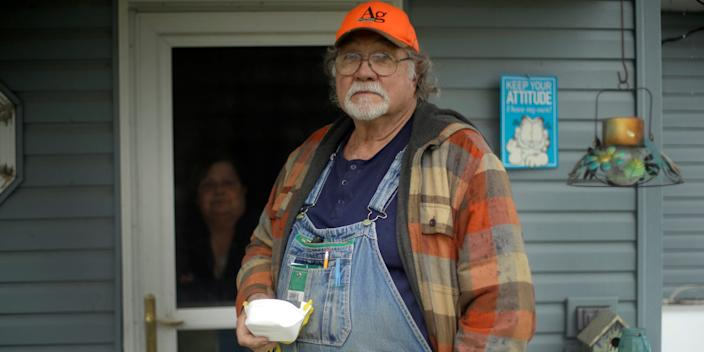 <br>Dennis Ruhnke holds two of his remaining N-95 masks as he stands with his wife, Sharon at their home near Troy, Kan. Friday, April 24, 2020.