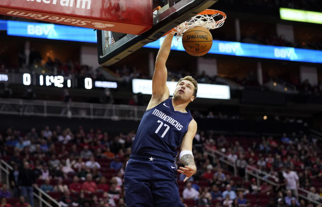 Dallas Mavericks' Luka Doncic dunks the ball against the Houston Rockets during the first half of an NBA basketball game Sunday, Nov. 24, 2019, in Houston. (AP Photo/David J. Phillip)