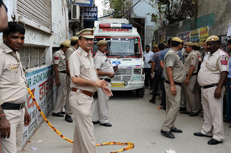 An ambulance enters the street where 11 family members were found dead inside their home in the neighbourhood of Burari in New Delhi