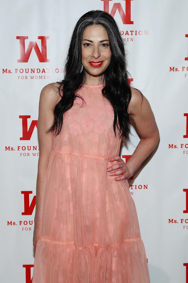 Stacy London poses wearing a pink dress