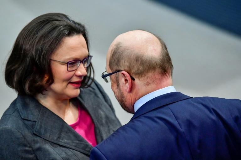 Andrea Nahles greets her predecessor Martin Schulz, who led the party to a dismal result in elections last year