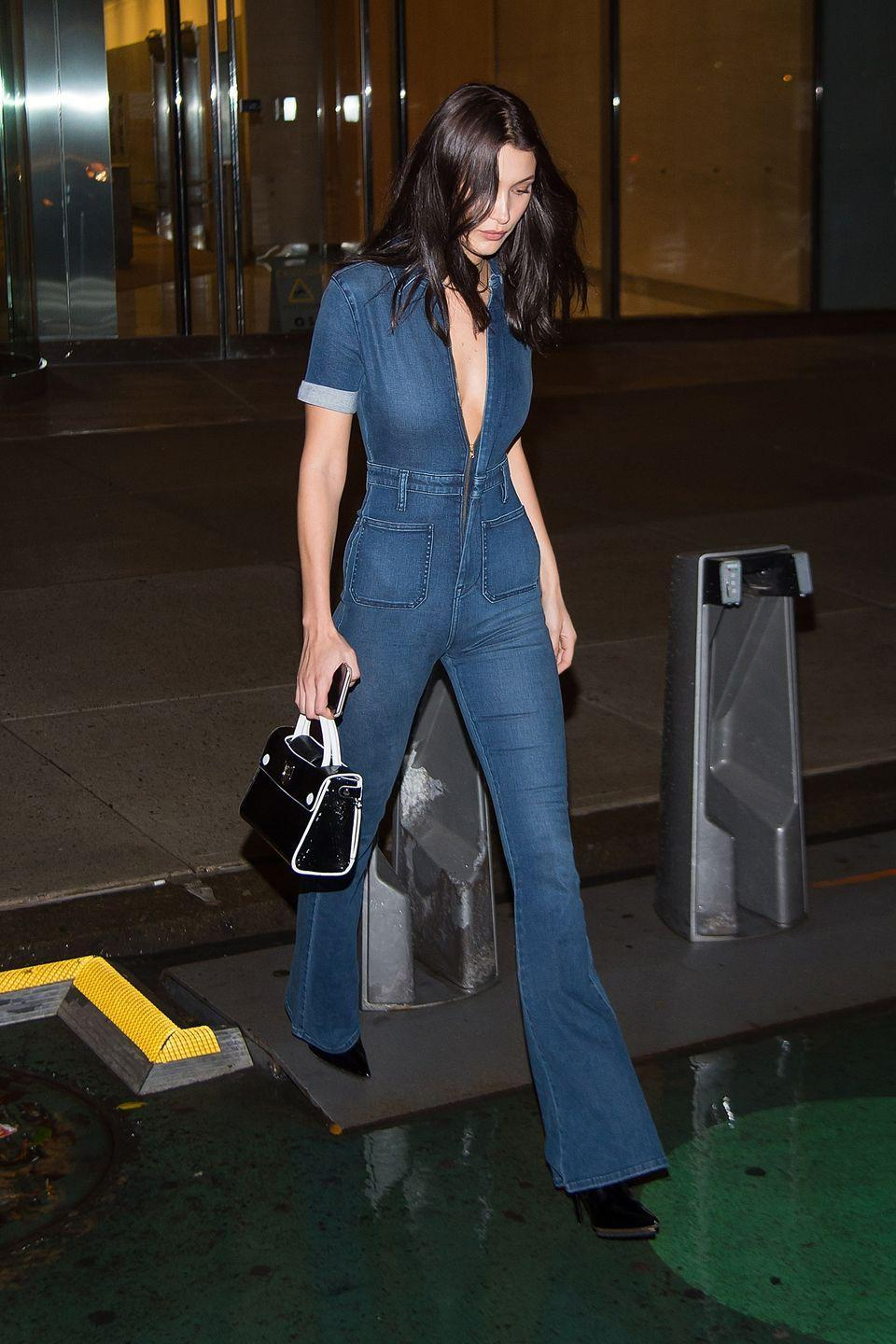 <p>In a v-neck darkwash denim jumpsuit by Second Skin Overalls, a black and white handbag and black pointed-toe booties while out in New York. </p>