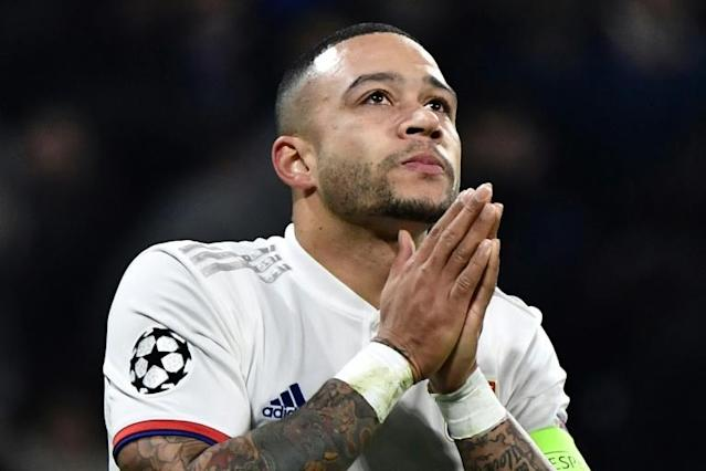 Memphis Depay could be left praying to get fit in time for Euro 2020 after a potential cruciate ligament injury (AFP Photo/JEFF PACHOUD)